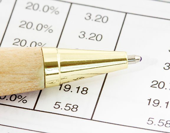 Pen on the financial spreadsheet